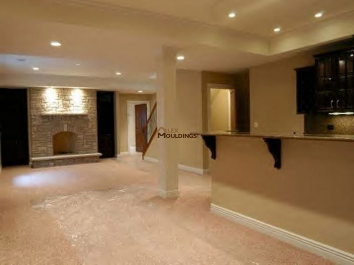 basement with fireplace and kitchenette