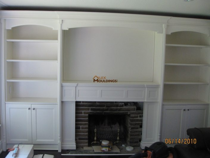 wall unit with a fireplace mantel