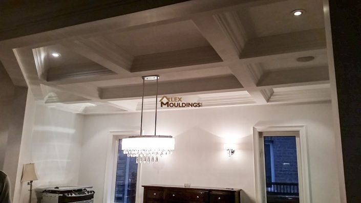 Coffered Ceiling beams with accent lighting in dinning rom