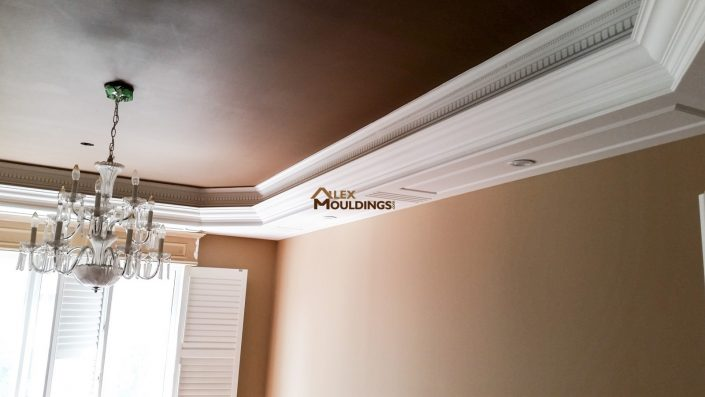 Tray ceiling beams with decorative mouldings