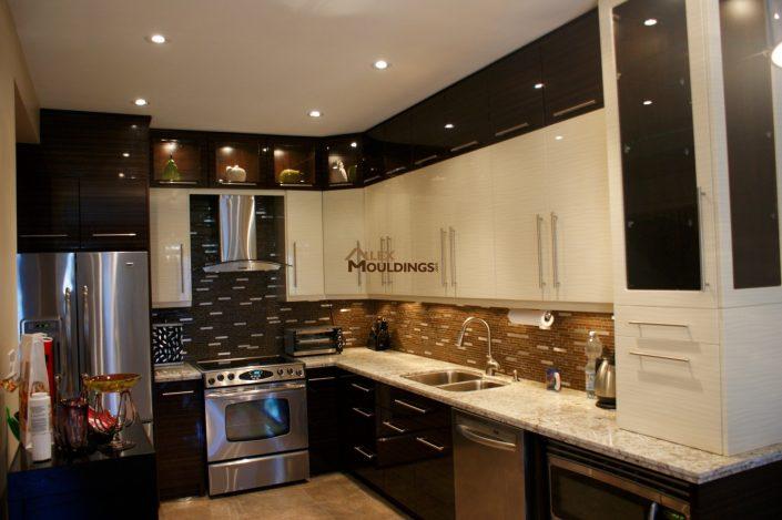 white painted cabinets with dark backsplash