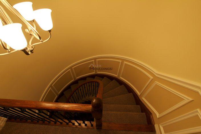 Curvy stairway half wall frames