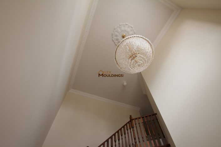 high ceiling mouldings above staircase