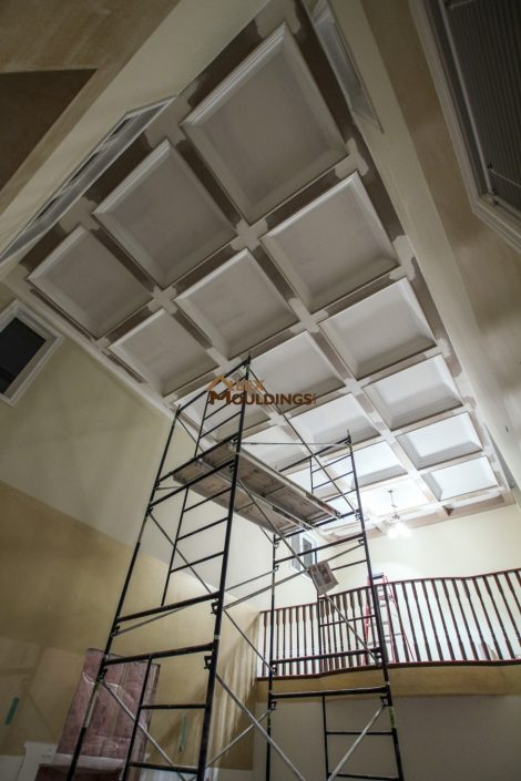 Waffle ceiling installation on a high ceiling