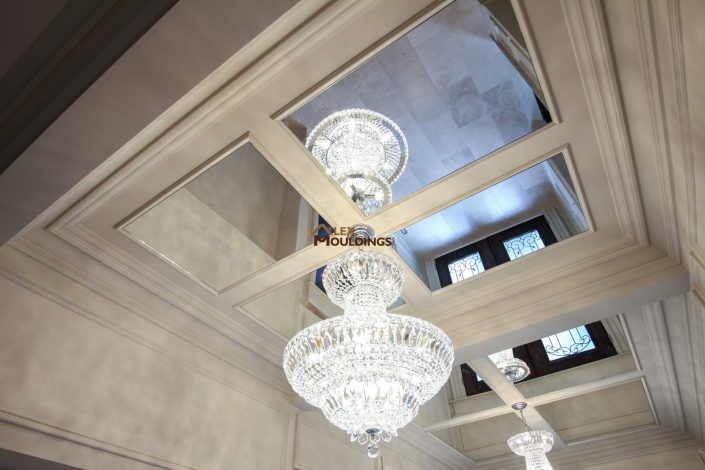 coffered ceiling with mirrors and cahndalier