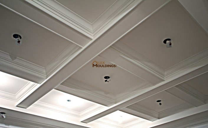 Beamed ceiling with crown mouldings