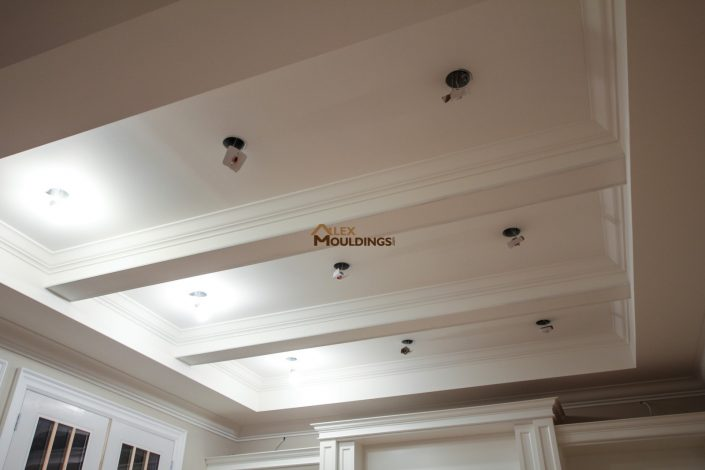Ceiling beams with crown moulding trims