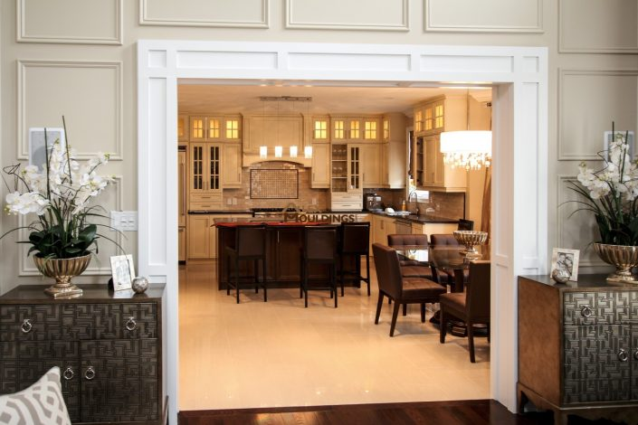 Cased door opening design with above wall trim