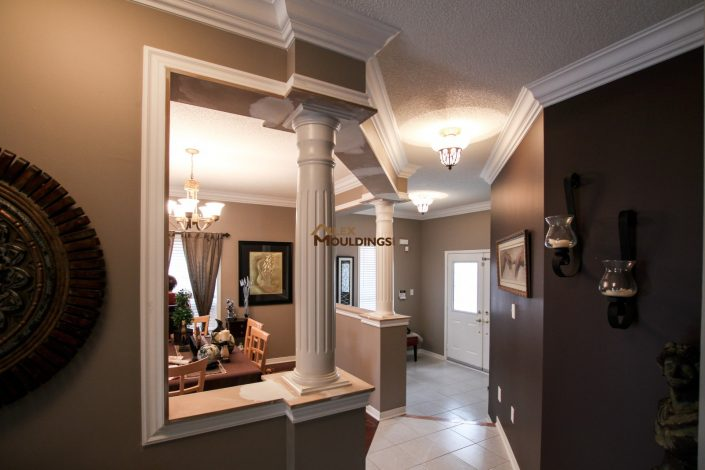 Cased niche with column and hallway crown moulding