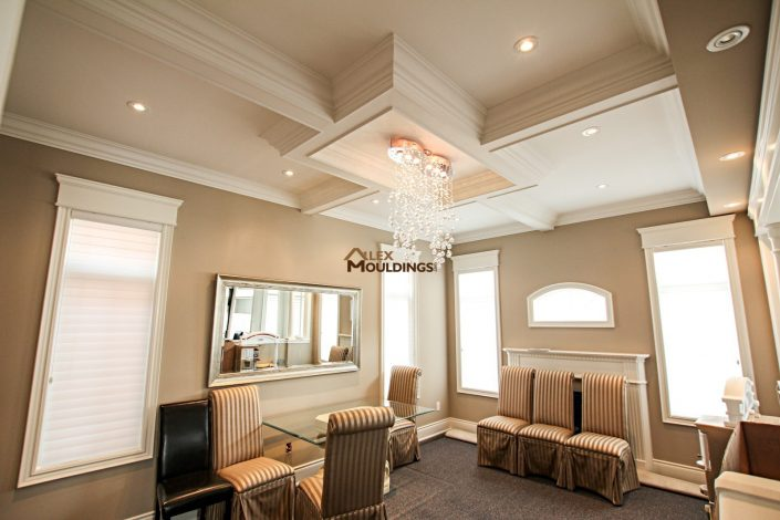 Dining room ceiling box with accent chandalier
