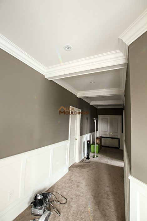 Hallway designed ceiling with waiscotting
