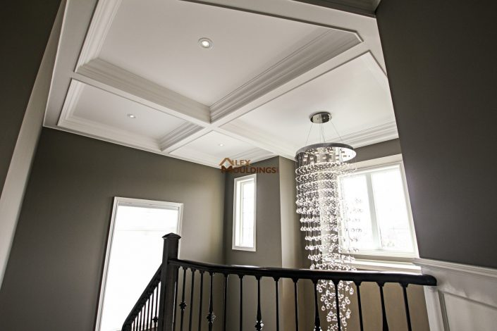 Coffered ceiling above stairway
