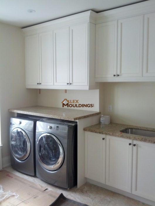 white laundry room cabinets