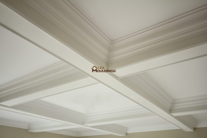 Beams with crown mouldings trimming inside boxes