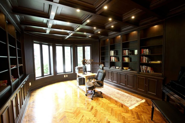 Dark wood waffle ceiling in a library office