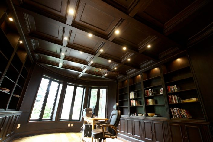 dark wood coffered ceiling and built ins