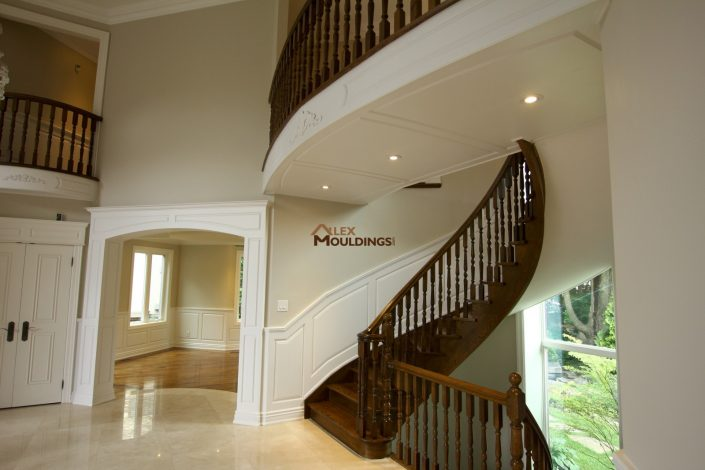 wainscoting, cased door opening and ceiling panels