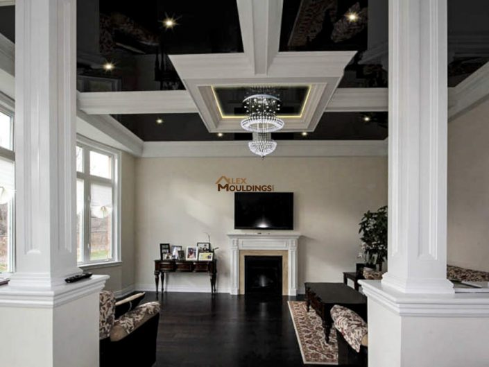 Ceiling beamed design built over a stretch ceiling
