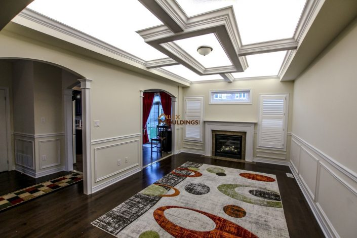 Living room designed with ceiling box and wall trims