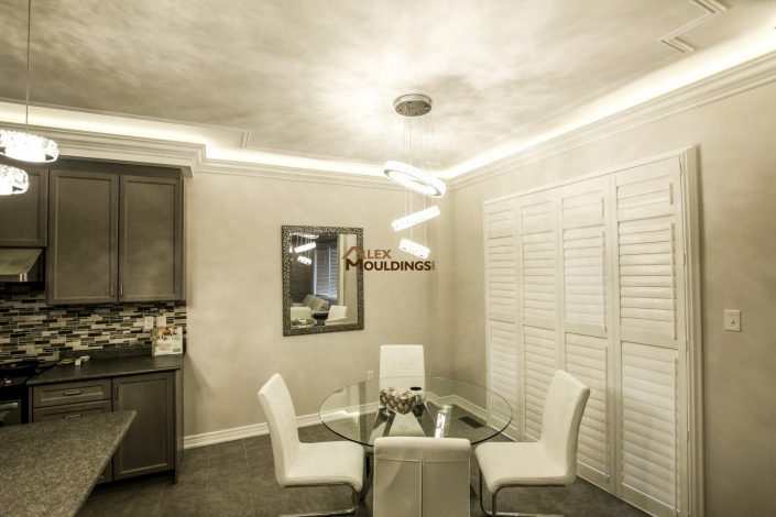 Dropped mouldings with cove lighting
