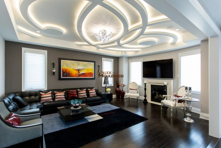 living room wavy design ceiling with lighting