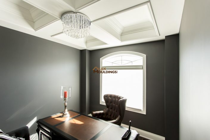 Large beams with crown mouldings and accent lighting