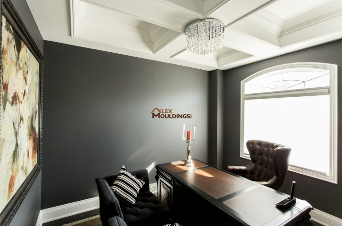 white coffered ceiling contrasting with dark walls