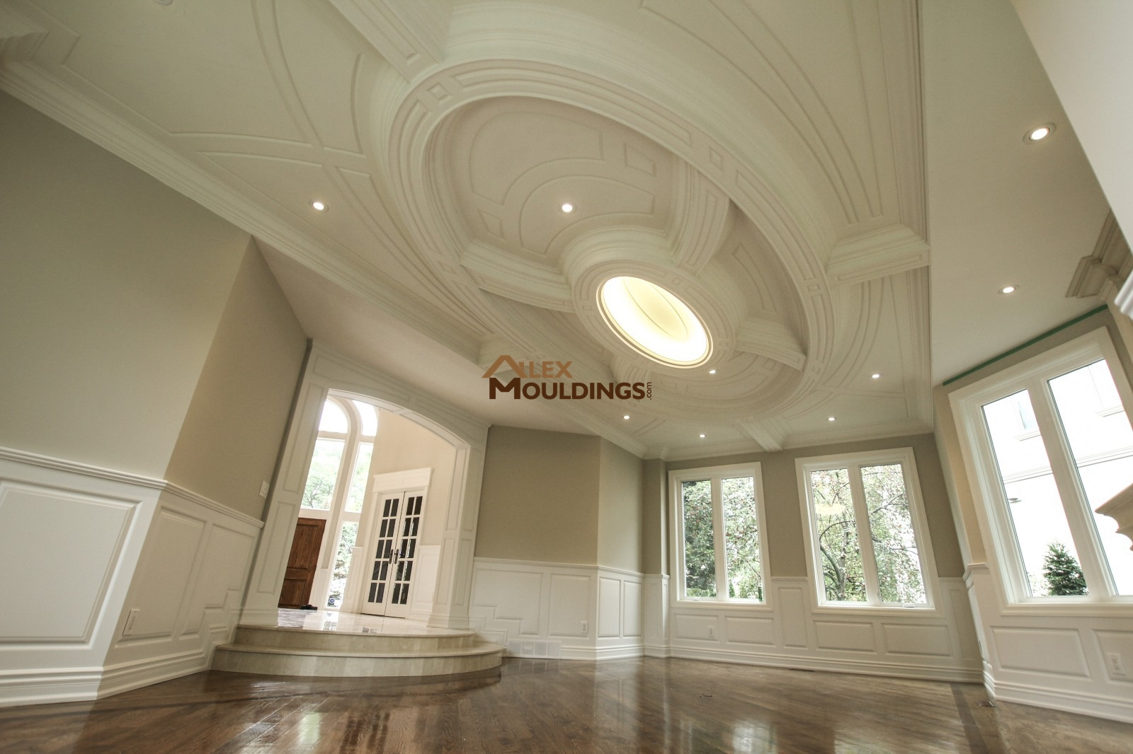 With a simple trim line running the place of the ceiling and contrasting colors one can easily create the coffered tray ceiling effect