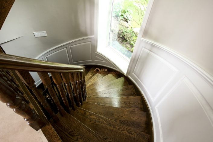 curved stairs wainscoting design