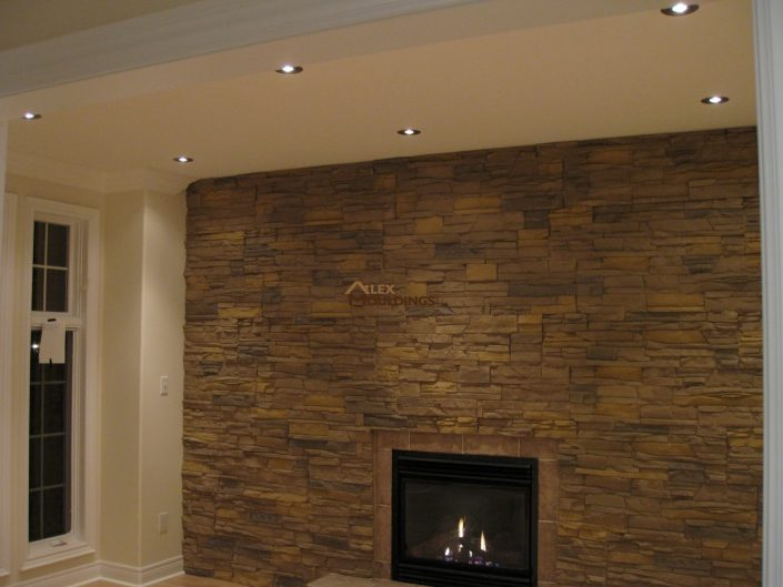 fireplace accent wall with pot lights